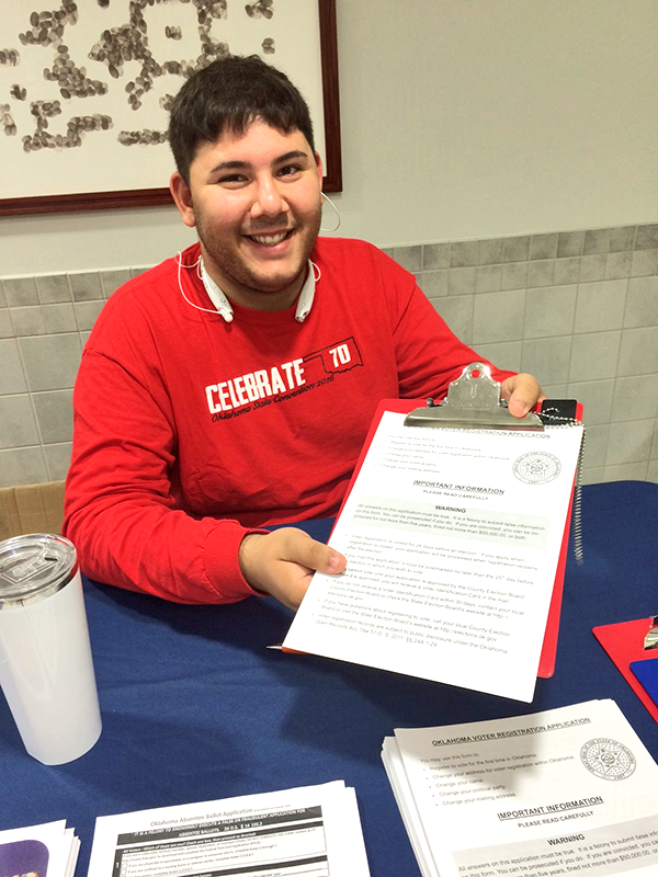 Daniel Rexach, a psychology freshman from Chelsea and a Student Government Association senator, volunteers to register students to vote during Rogers State University's Rock the Vote Week in September. RSU registered 6.4 percent of its in-state full-time enrolled students, the second-highest percentage of all participating institutions with 3,000 or fewer full-time enrolled students.