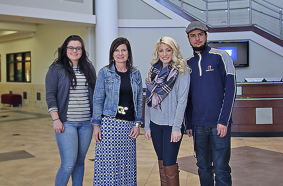 Students posing for photo in Centennial Center.