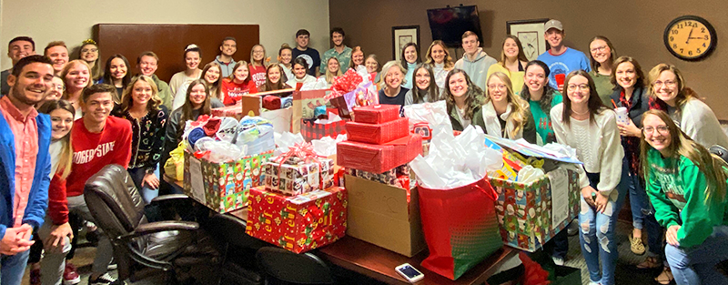 students posing with donated christmas gifts