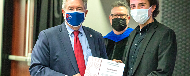Pictured L-R: Dr. Larry Rice, RSU president; Dr. Kenneth Hicks, department head and professor of history and political science; RSU student Cade Russell